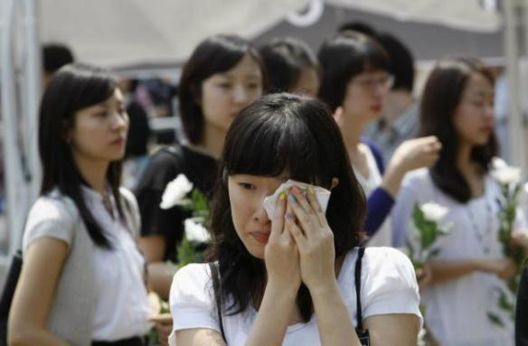 Wiping away tears - Image from www.ibtimes.com