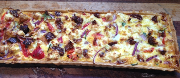 Delicious basil, feta, roasted capsicum (bell pepper) and marinated fig vegetable tart.