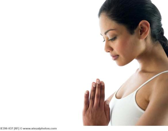 Woman in prayer pose