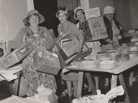 Unpacking cakes for judging - Image from John Oxley Library