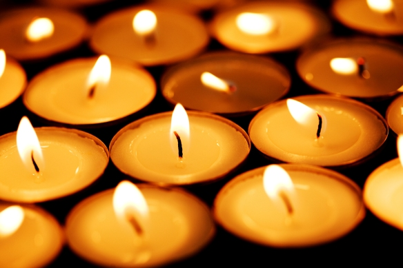 bigstockphoto_candles_shining_in_darkness_47345701