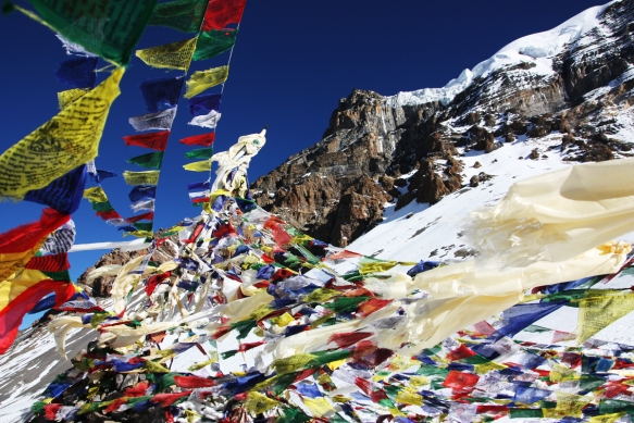 Prayer Flags at Thorang La Pass, Nepal. Image from Budget Your Trip