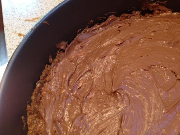smooth cheesecake into tin
